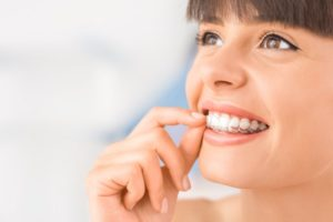 a woman with Invisalign